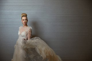 styled-shoot-wedding-gown-flowing-skirt-inbal-dror-fashion-designer-top-knot-inspiration