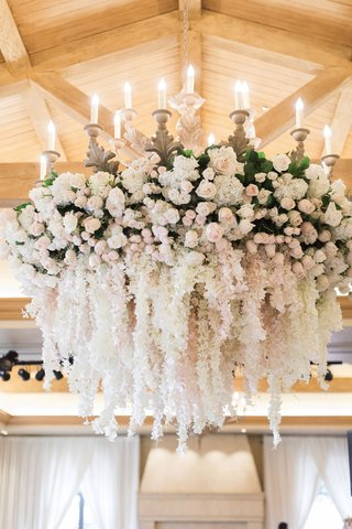 wedding-reception-chandelier-white-pink-flowers-cascading-blooms-over-dance-floor