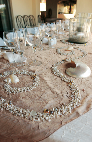 seashells-and-sea-glass-on-sand-colored-tablecloth