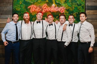wedding-reception-moss-photo-booth-backdrop-neon-sign-groom-groomsmen-in-suspenders-bow-ties