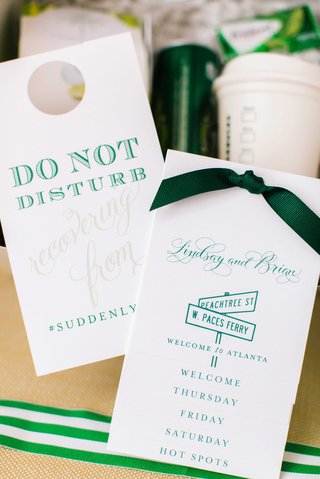 white-and-green-paper-goods-for-wedding-welcome-bag-do-not-disturb-sign-wedding-weekend-itinerary