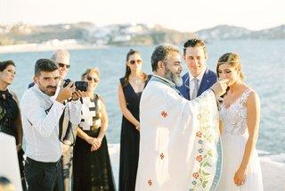 greek-orthodox-wedding-ceremony-at-aegean-sea-view-church-in-mykonos-greece