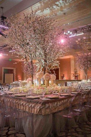 tall-cherry-blossom-tree-centerpieces-at-tamra-barney-wedding