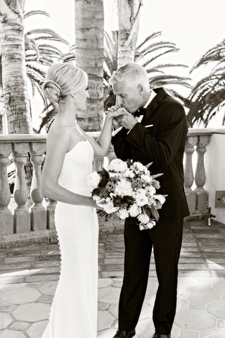black-and-white-photo-of-bride-in-ines-di-santo-wedding-dress-and-father-of-bride-kissing-hand