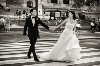 black-and-white-photo-of-chinese-american-bride-and-groom-in-crosswalk-of-new-york-city-street