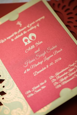 invitation-for-hindu-wedding-with-red-background-and-green-sleeve-with-gold-pattern