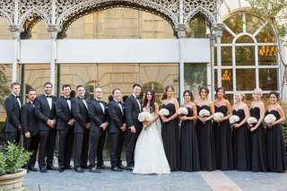bride-groom-white-dress-black-attire-outfits-dresses-groomsmen-bridesmaids-white-blush-bouquets