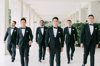 wedding-in-the-south-of-france-groomsmen-in-tuxedos-with-bow-ties-and-pocket-squares