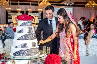 indian-bride-and-groom-cut-cake-at-reception