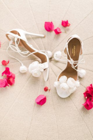 white-aquazzura-strappy-white-heels-with-pom-poms-flowers-on-toe-and-straps