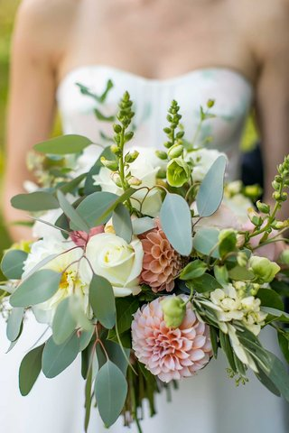 wedding-bouquet-greenery-pink-dahlia-white-rose-bride-in-strapless-wedding-dress-flower-design
