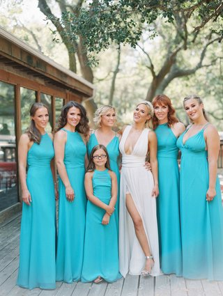bridesmaids-in-long-turquoise-dresses-with-mismatched-necklines-flower-girl-junior-bridesmaid-lana