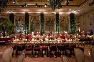 wedding-reception-gold-chairs-burgundy-green-hedge-walls-mirror-trees-as-centerpieces-red-flowers