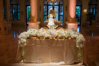 wedding-reception-sweetheart-table-with-white-flower-garland-runner-and-gold-linen