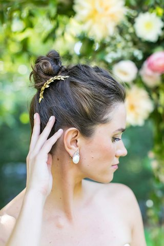 bride-with-hair-up-in-high-bun-gold-laurel-wreath-headpiece-large-earrings-manicure