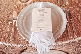 white-plate-with-lace-trim-napkin-and-menu-on-sequin-tablecloth