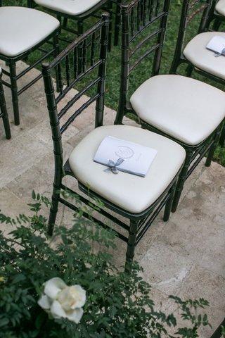 wedding-ceremony-hotel-bel-air-black-chiavari-chair-ivory-cushion-ceremony-program-bow