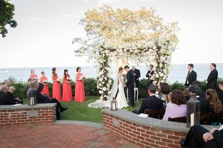 bride-and-groom-at-altar-in-front-of-lake-at-golf-club