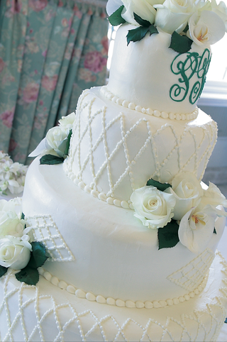 white-buttercream-cake-with-white-roses-and-monogram