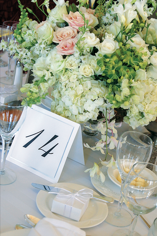 table-number-in-front-of-centerpiece-with-white-and-pink-flowers