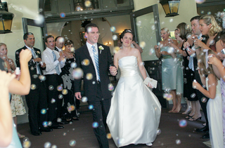 bride-and-groom-walk-through-bubbles-during-grand-exit