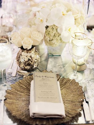 wedding-menu-with-laura-hooper-calligraphy-on-gold-pattern-charger-plate-with-gold-mercury-glass
