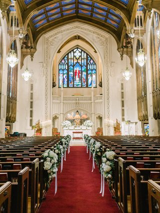 wedding-ceremony-venue-peachtree-christian-church-atlanta-stained-glass-windows-pews-red-aisle