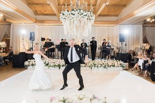 bride-and-groom-on-white-dance-floor-flower-chandelier-cute-dance-between-bride-and-father