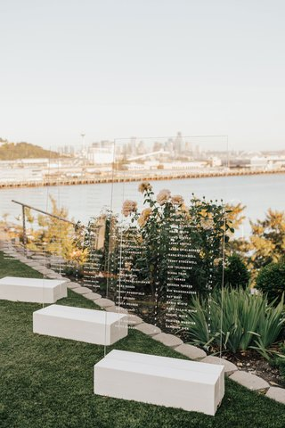 acrylic-lucite-seating-chart-for-wedding-in-front-of-view-puget-sound-seattle-skyline