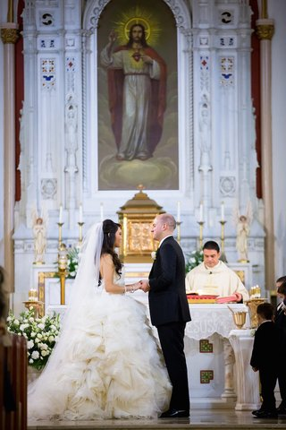 bride-in-a-strapless-lazaro-dress-with-ruffled-skirt-veil-groom-in-black-tuxedo-our-lady-of-fati