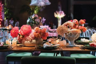 wedding reception unique centerpieces shell candle holders dahlia rose peony flowers green velvet chairs