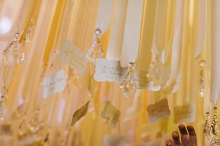 whimsical-seating-card-display-hanging-from-ribbons