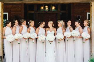 high-neck-halter-gown-bridesmaid-dresses-in-pale-pastel-hue-white-flowers-and-flowers-in-hair