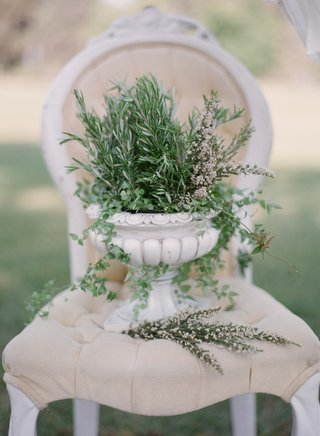 white-stone-urn-with-fresh-herbs-on-tufted-throne-chair