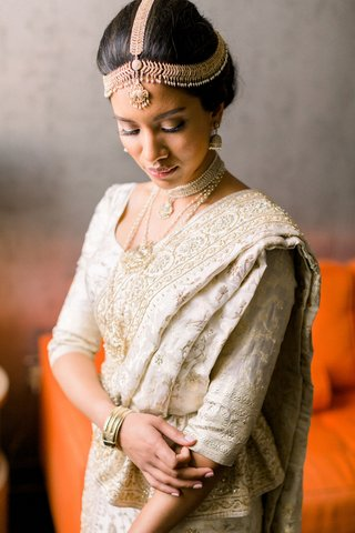 sri-lankan-south-asian-bride-in-ivory-and-gold-sari-with-headpiece