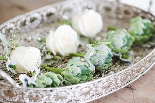 white-rose-boutonniere-and-succulent-boutonnieres-at-destination-wedding