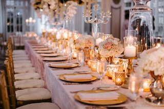 wedding-reception-pink-linen-long-table-gold-chair-charger-plate-candle-votive-vase-candelabra