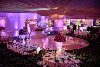 wedding-reception-glam-sweetheart-table-on-stage-circle-dance-floor-gold-chairs-purple-lighting-pink