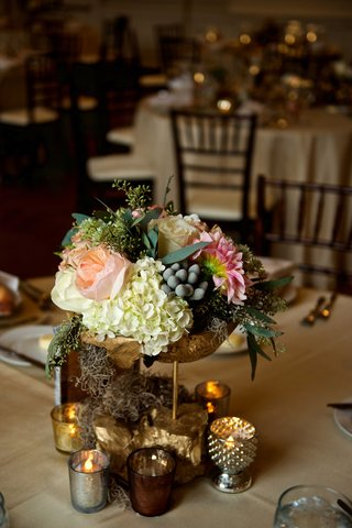 pink-dahlia-peach-garden-rose-winter-berries-ivory-hydrangea-moss-gold-stand-candle-votives