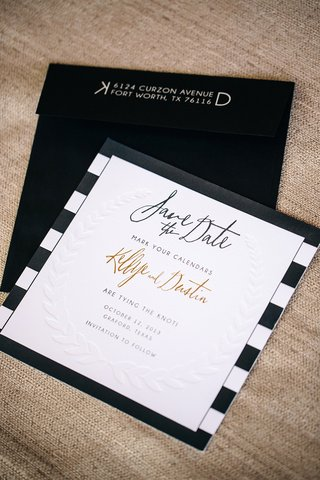 letterpress-leaf-motif-on-card-with-black-envelope