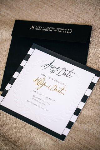 letterpress-leaf-motif-on-card-with-black-envelope