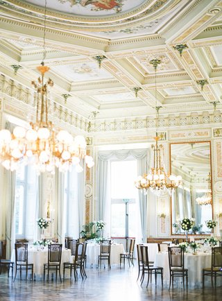 wedding-reception-lake-como-italy-hand-painted-ceilings-gold-chandelier-cane-back-chairs-flowers