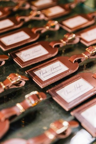 embossed-leather-luggage-tags-in-calligraphy-as-escort-cards-and-favors