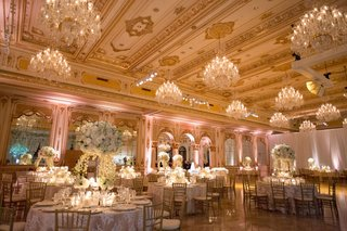wedding-reception-opulent-sophisticated-ballroom-with-chandeliers-gold-ceilings-high-low-centerpiece