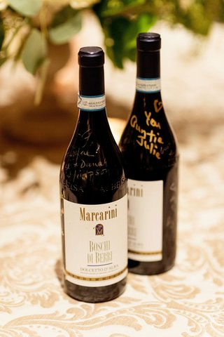 marcarini-boschi-di-berri-dolcetto-dalba-wine-bottles-signed-by-guests-with-gold-and-silver-sharpie