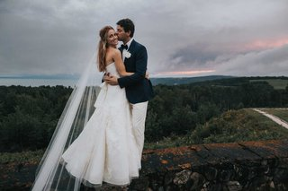 sunset-wedding-photo-strapless-vera-wang-wedding-dress-in-canada-veil-long-hair