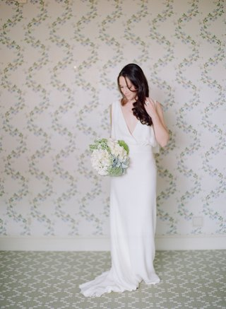 bride-wearing-long-wedding-dress-with-deep-v-neck