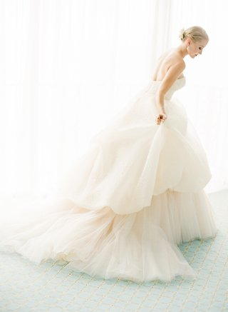 lazaro-strapless-blush-wedding-dress-on-blonde-bride