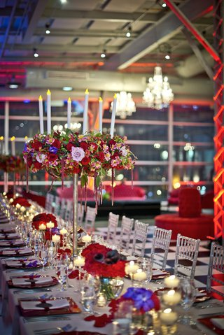 tall-centerpieces-with-red-and-pink-flowers-fake-candles-kings-table-long-reception-table