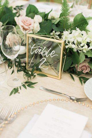wedding-reception-table-number-modern-calligraphy-on-wood-table-gold-geo-frame-clear-translucent